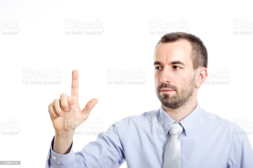 Young buinessman touching stock photo