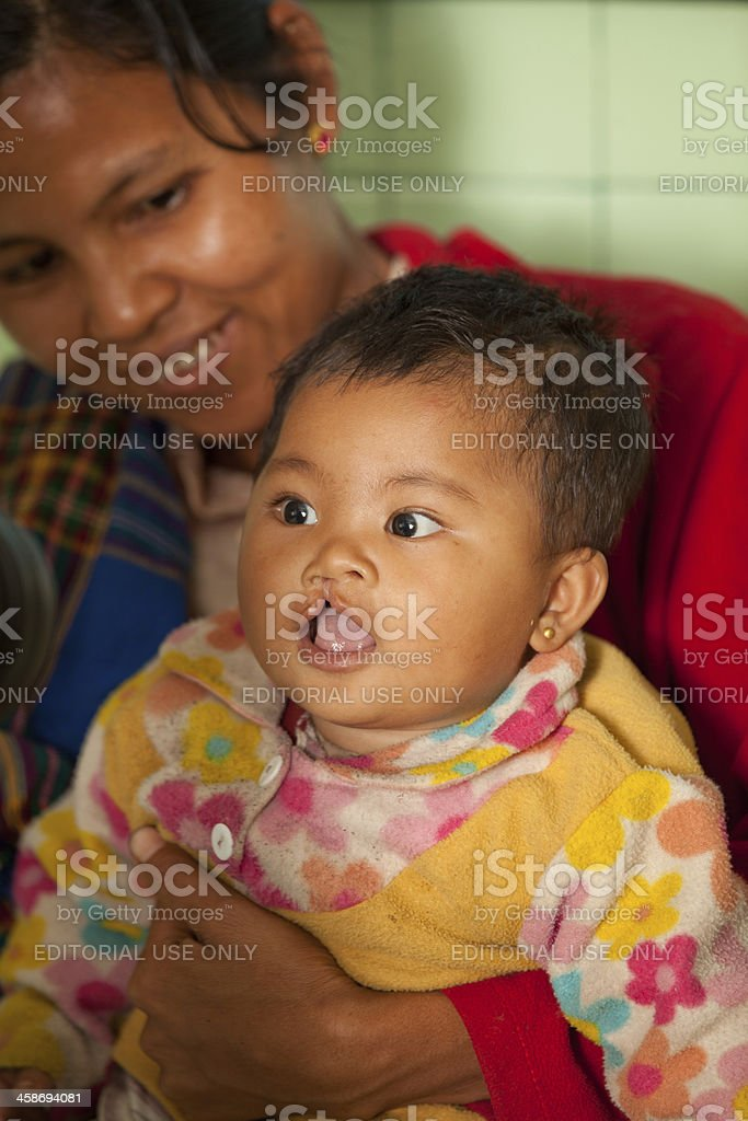 Young Burmese mother and child being examined by a doctor stock photo