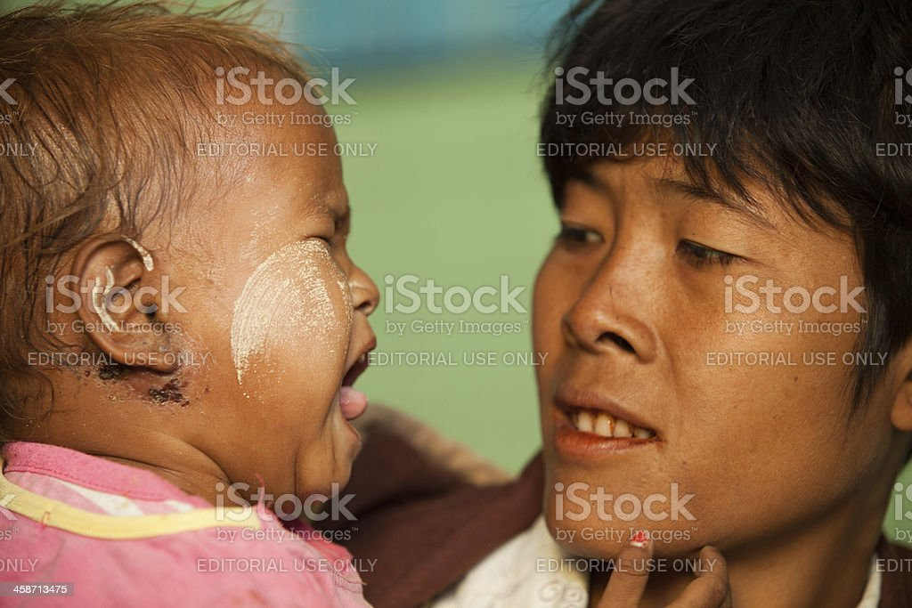 Young Burmese mother and child being examined by a doctor royalty-free stock photo