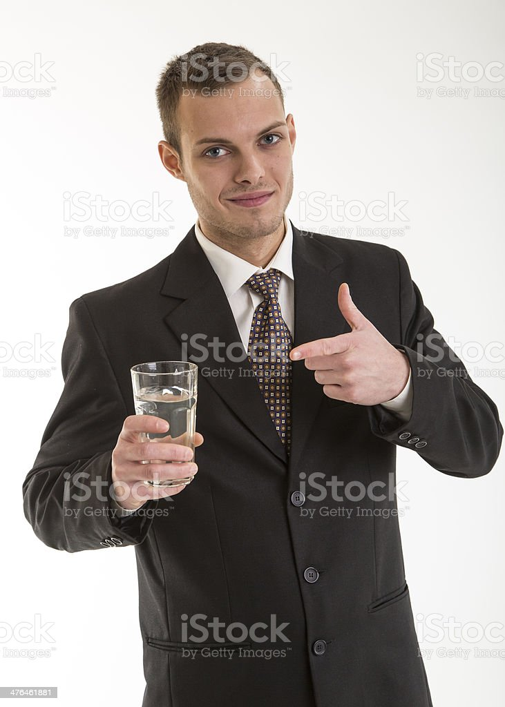 young busines man with glass of water stock photo