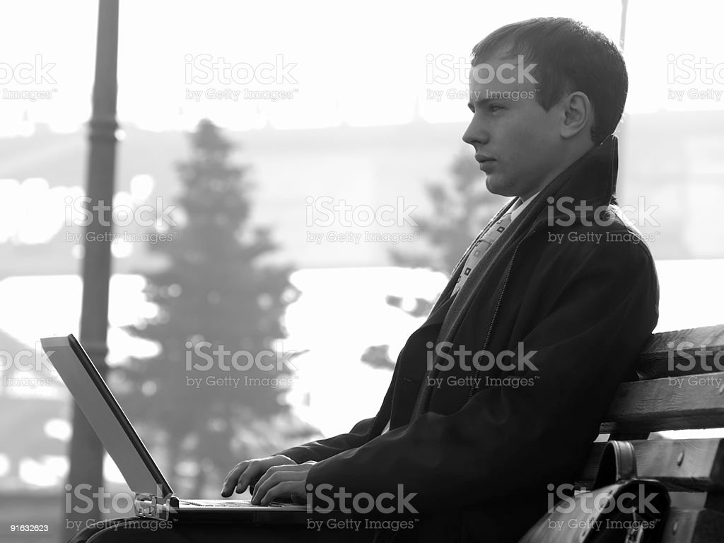 Young businesman with laptop royalty-free stock photo