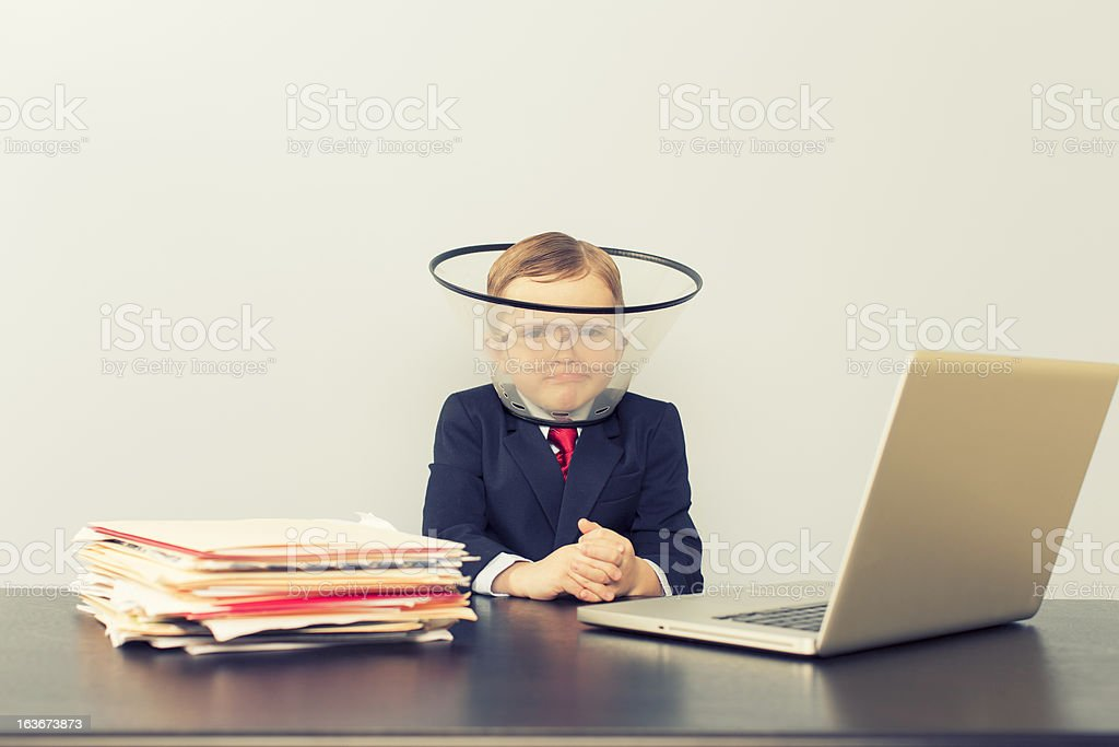 Young Business Boy at Laptop Wearing Dog Collar stock photo