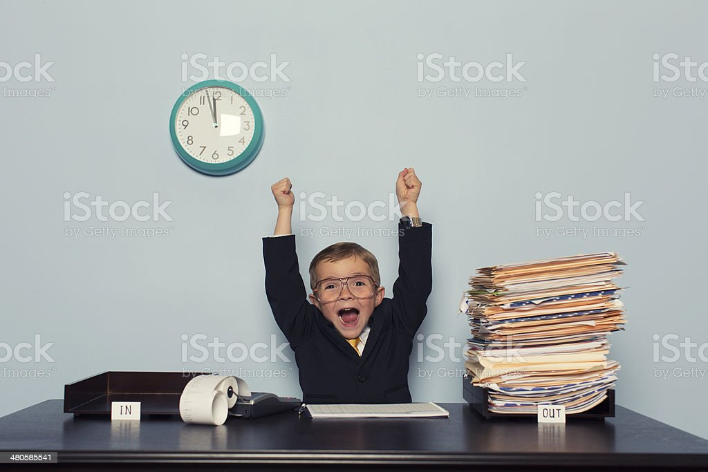 Young Business Boy Celebrates with Work Finished stock photo