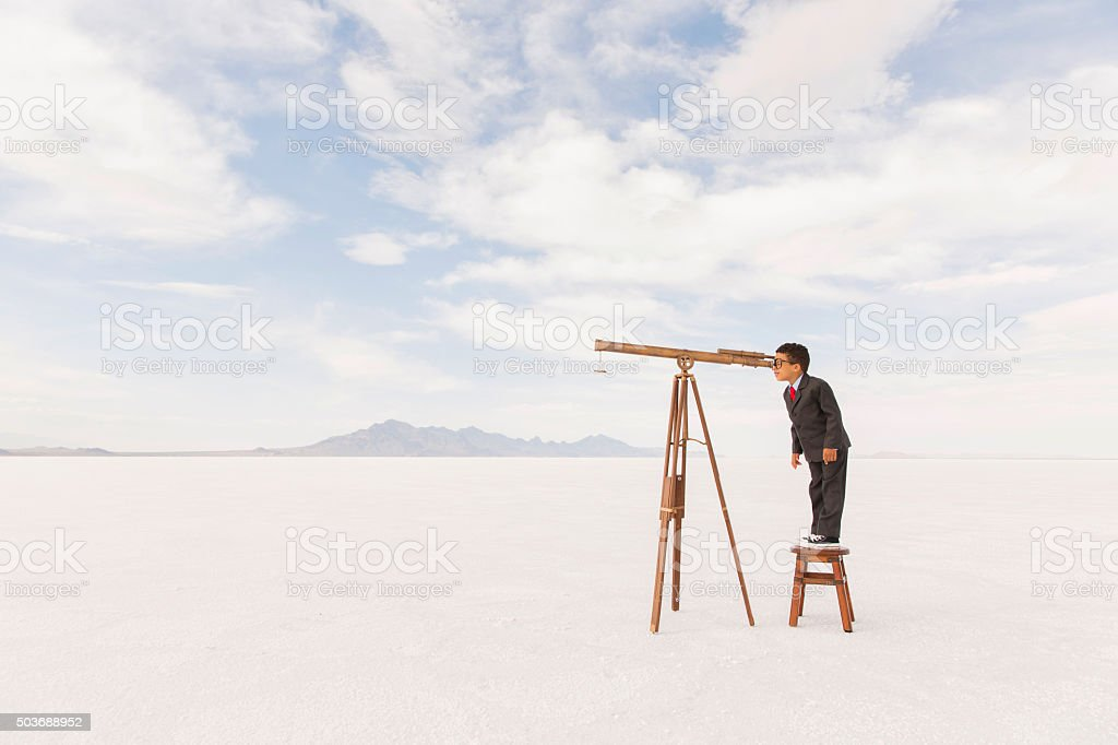 Young Business Boy Looking Through Telescope stock photo
