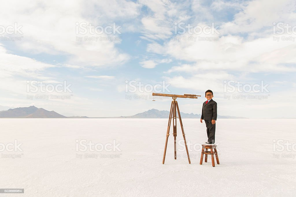 Young Business Boy with Telescope stock photo