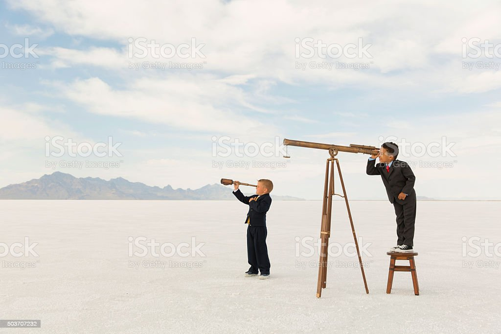 Young Business Boys Looking Through Telescopes stock photo