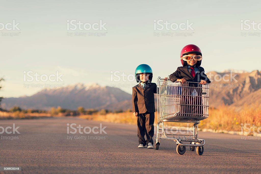 Young Business Boys Race in Shopping Cart stock photo