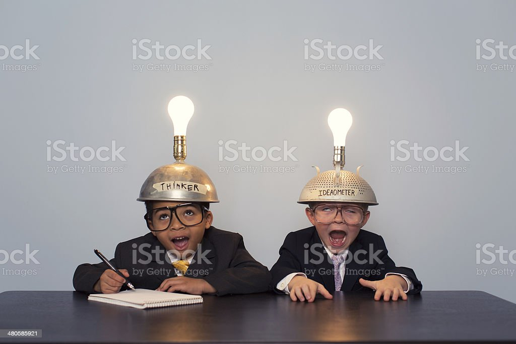 Young Business Boys Wearing Business Suits and Thinking Caps stock photo