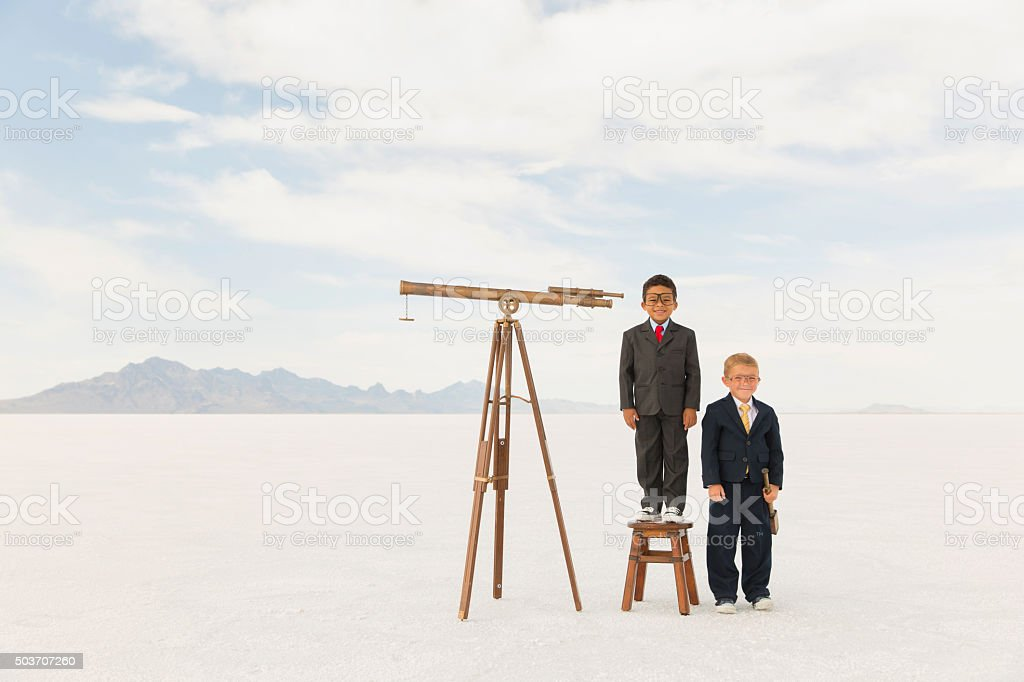 Young Business Boys with Telescopes stock photo