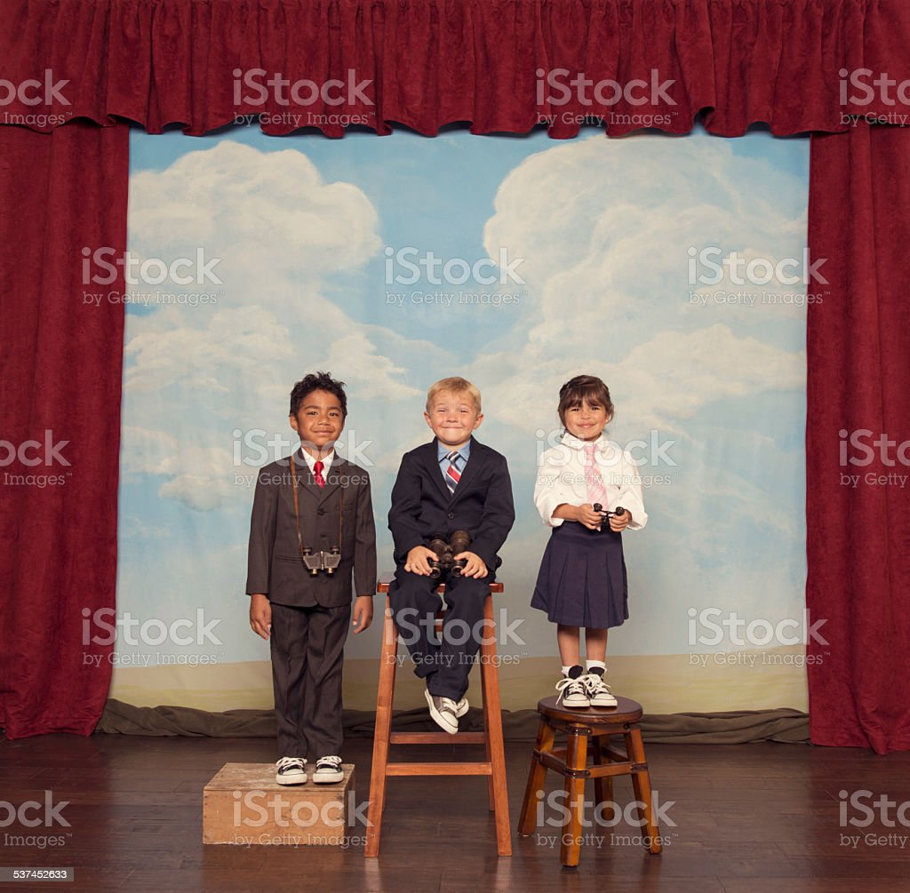 Young Business Children on Stage with Bionoculars stock photo