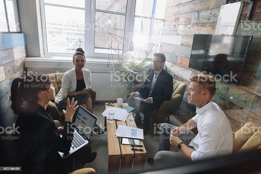 Young business colleagues meeting in modern office stock photo