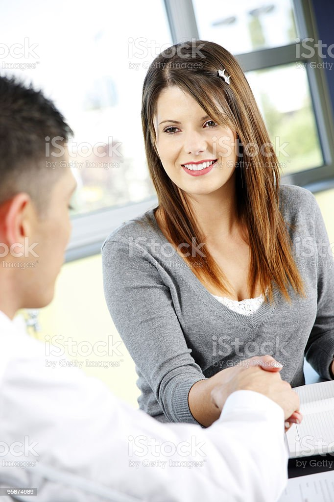 Young business colleagues shaking hands royalty-free stock photo