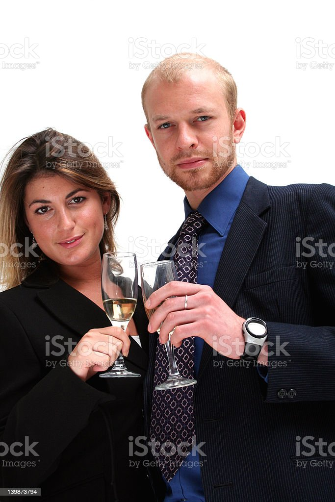 Young business couple - toasting success royalty-free stock photo