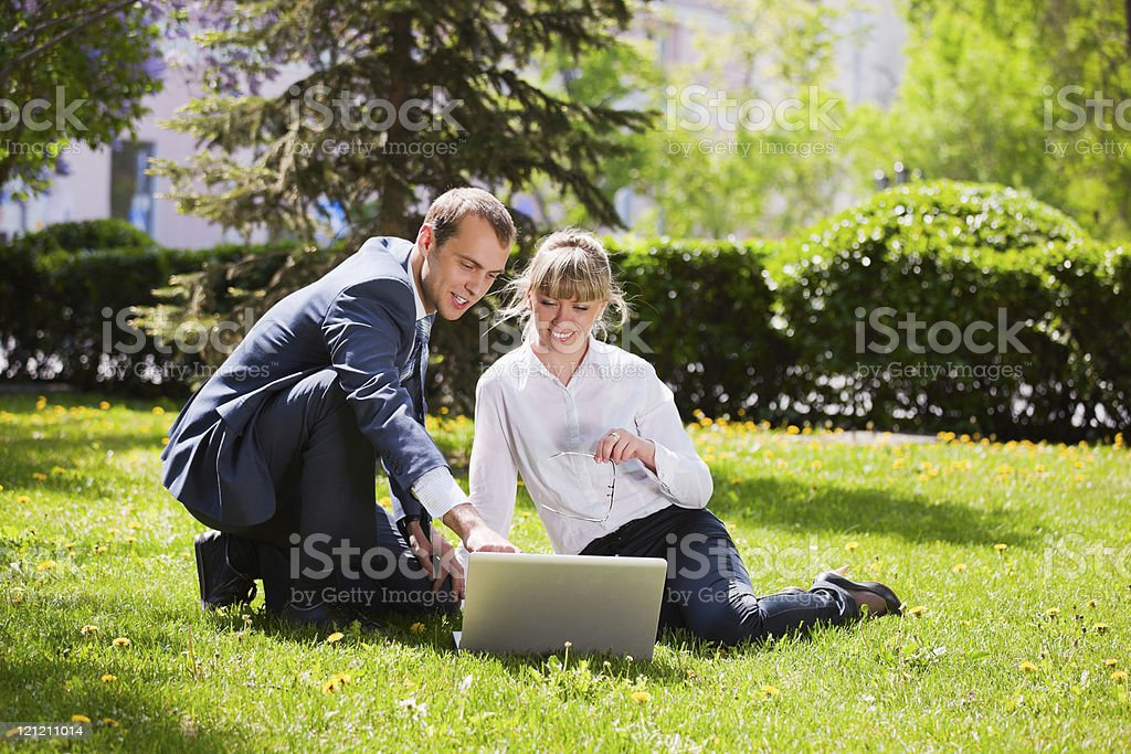 Young business couple with laptop royalty-free stock photo
