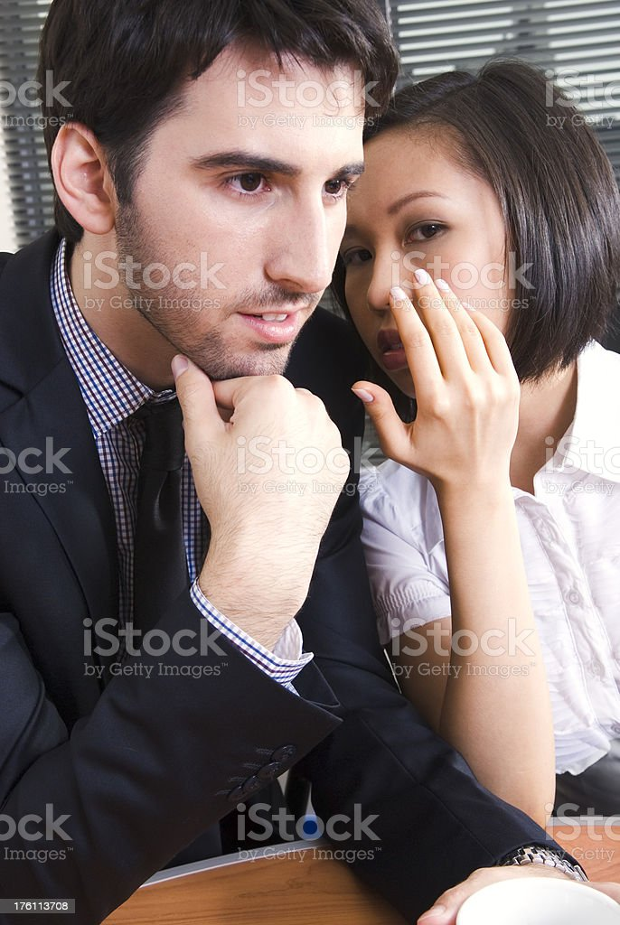 Young business co-workers are gossiping - III royalty-free stock photo