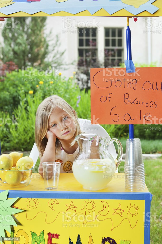 Young Business Entrepreneur with Recession Failing Lemonade Stand Vt royalty-free stock photo