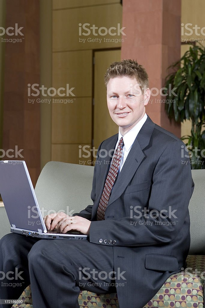 Young Business Executive with Laptop royalty-free stock photo