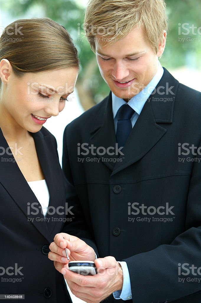 Young business executives using pda royalty-free stock photo