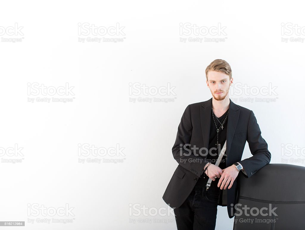 Young Business Founder's Portrait On White Wall Background stock photo