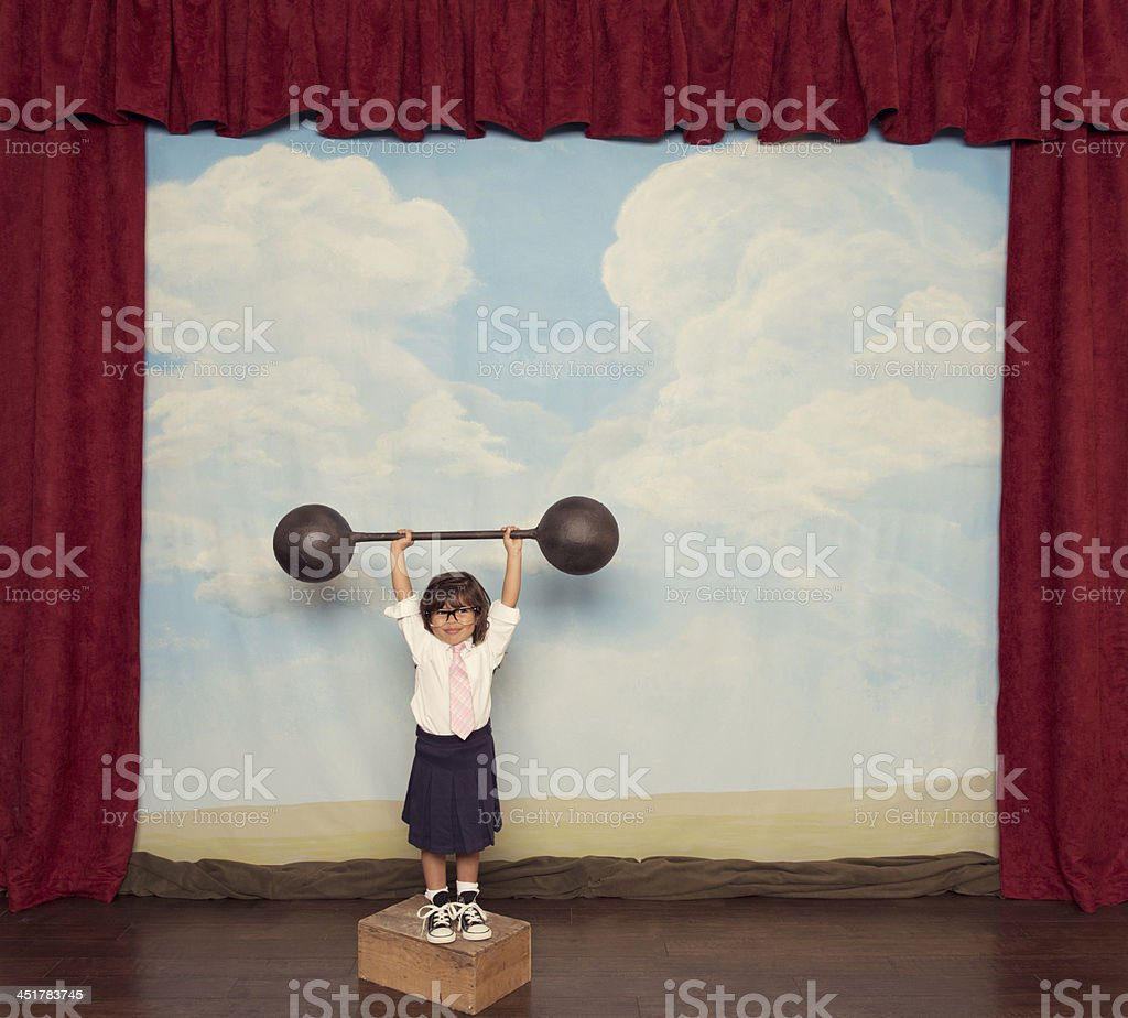 Young Business Girl Lifts Barbell on Stage stock photo