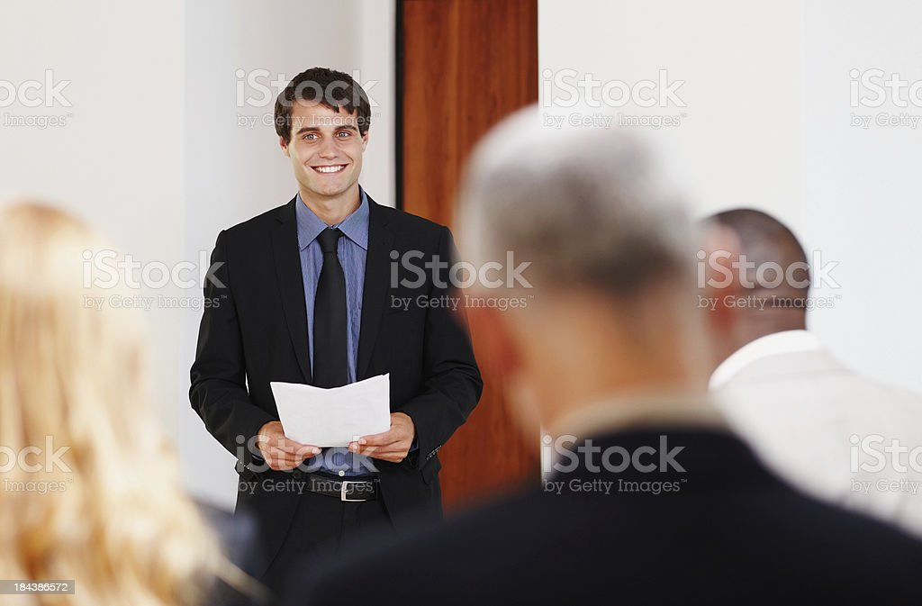 Young business giving a presentation royalty-free stock photo