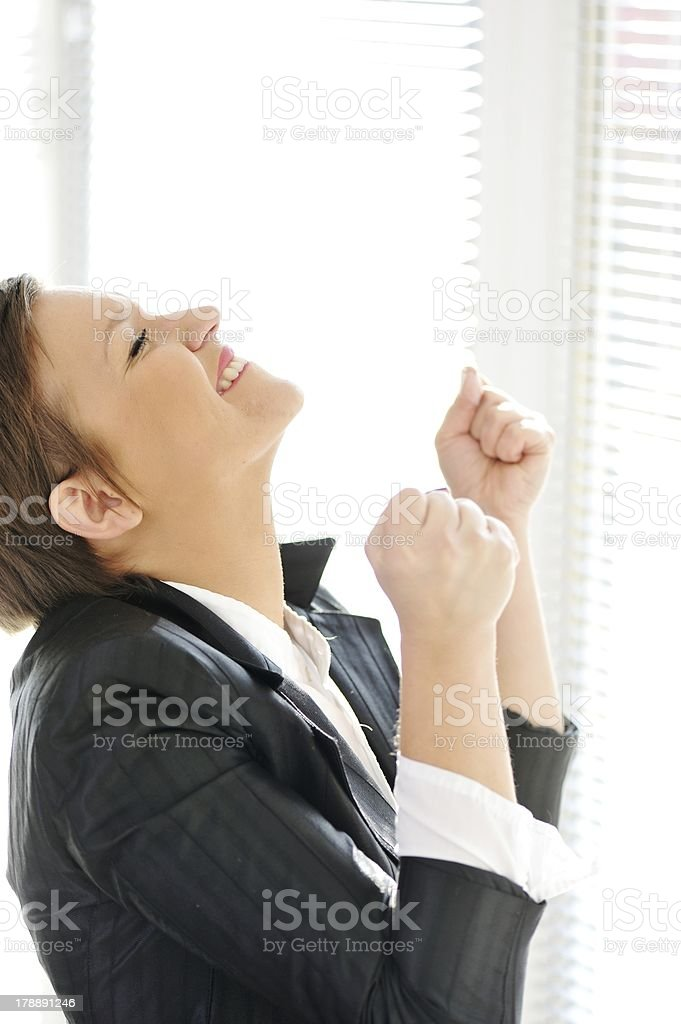 Young business happy excited winner woman at office celebrating royalty-free stock photo