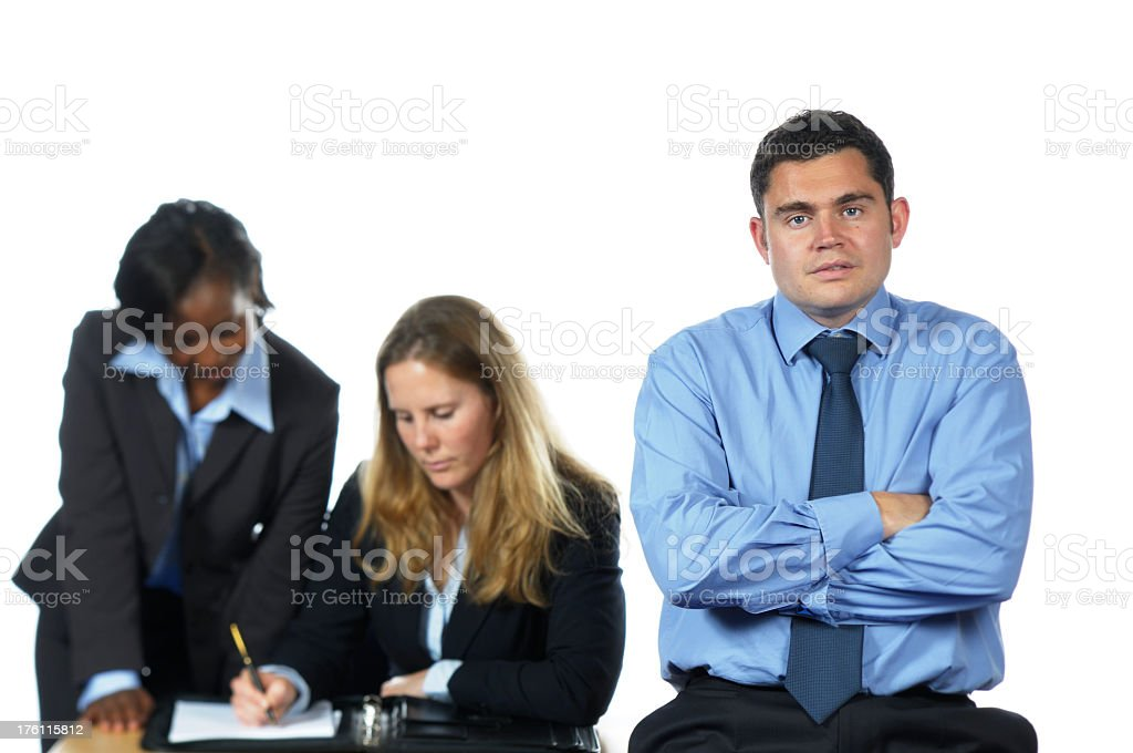 Young Business Man and his Team Working Behind Him stock photo
