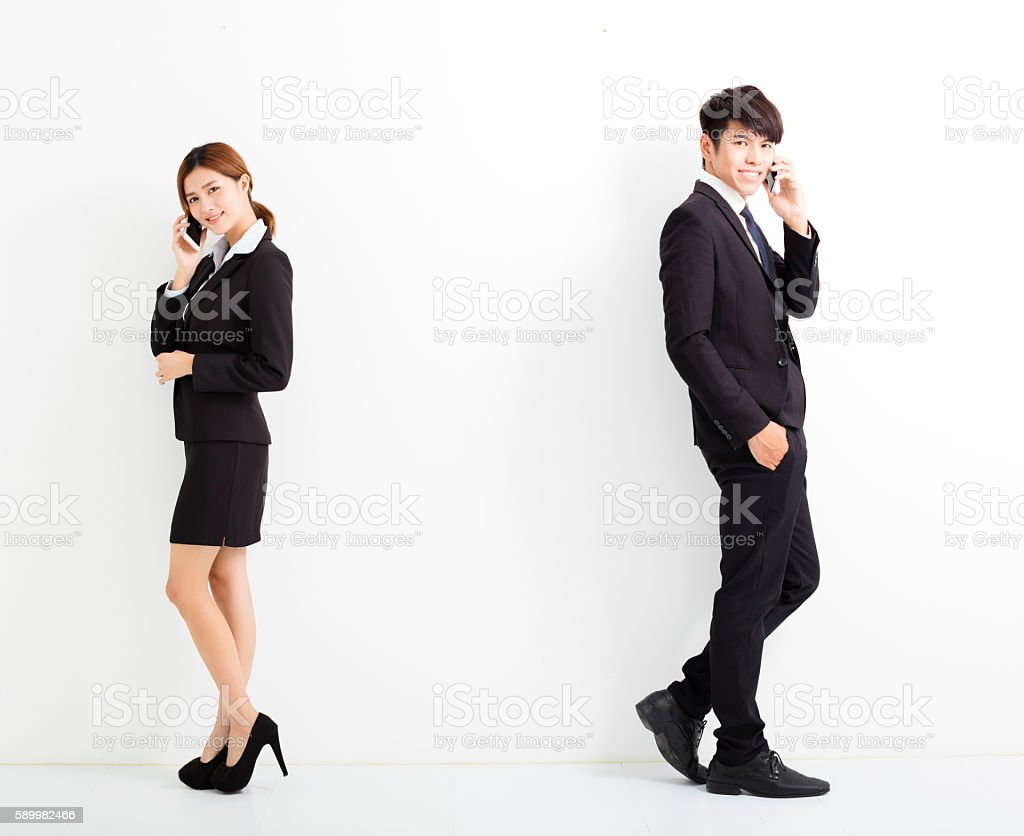 young business man and woman talking on the phone stock photo