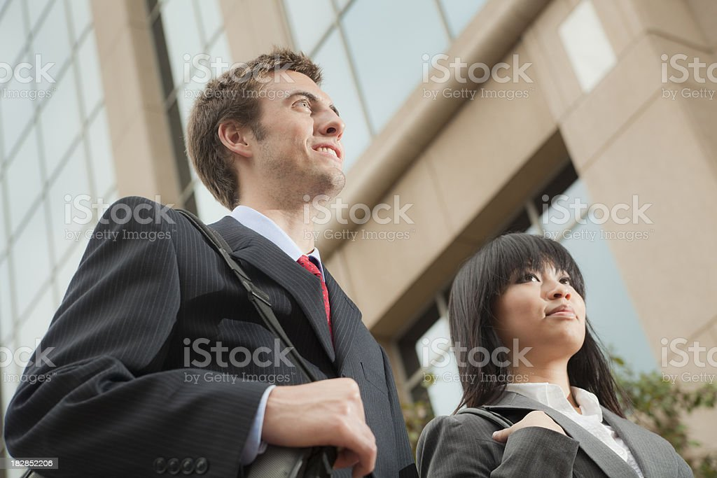 Young Business Man and Woman Workers Outside Office Building royalty-free stock photo