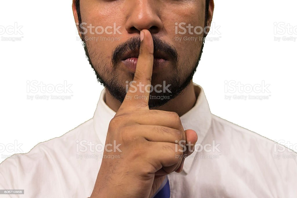 Young business man asking you to shut up! stock photo