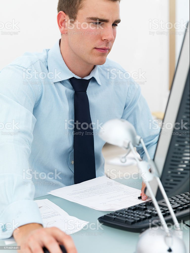 Young business man at desk using computer royalty-free stock photo