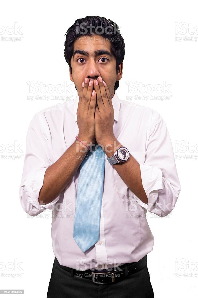 Young business man covering his mouth with hands. stock photo