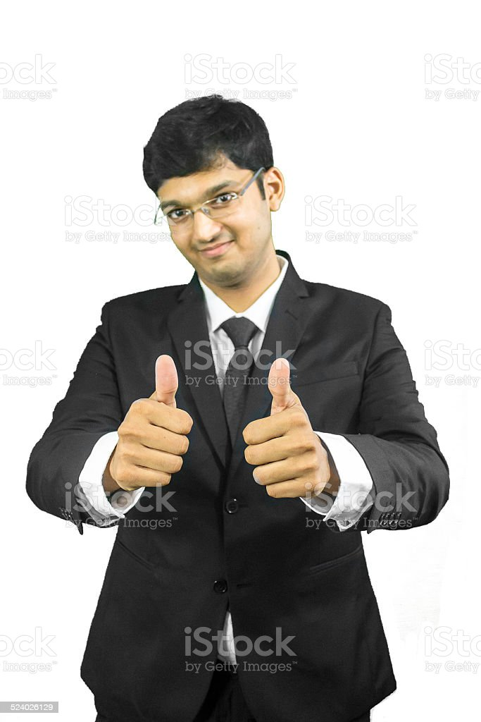 Young business man giving thumbs up stock photo