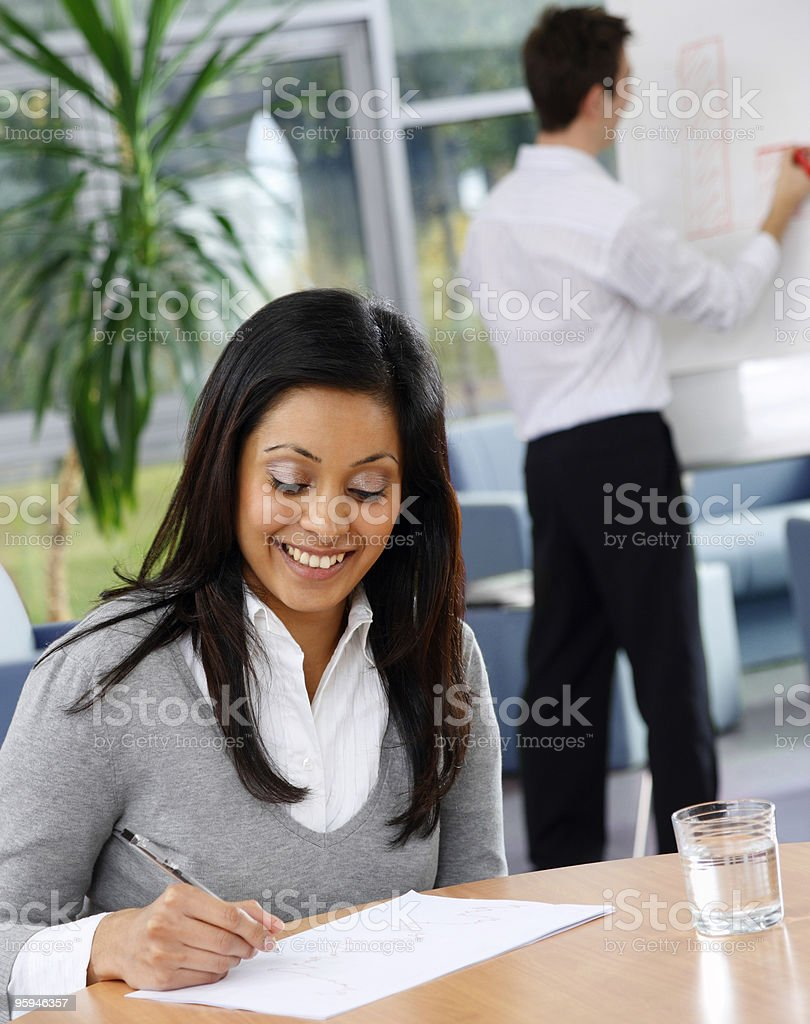 young Business man givings presentation to female indian colleague royalty-free stock photo