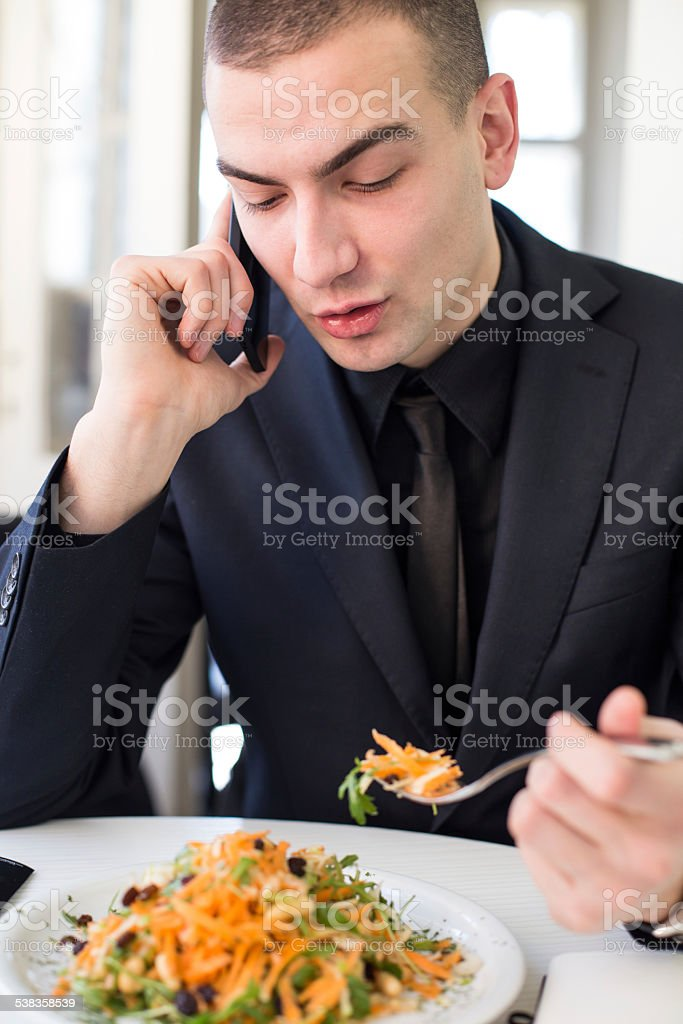 Young business man having healthy lunch stock photo