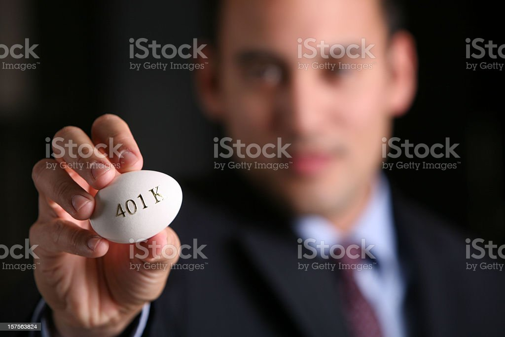 Young business man holding egg royalty-free stock photo