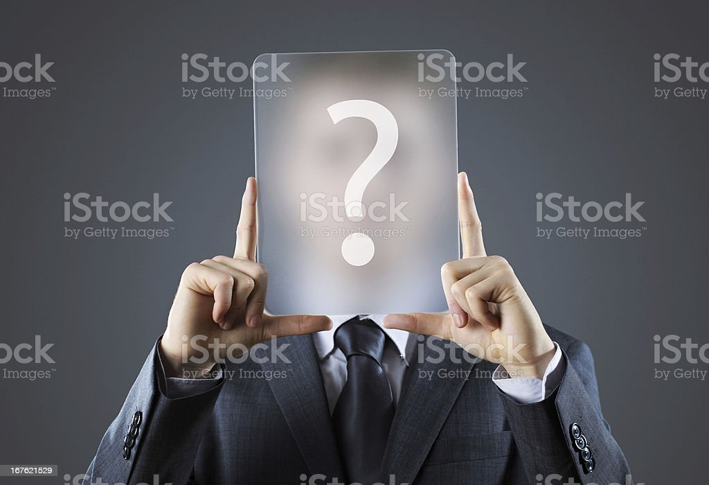 Young business man holding question mark signs stock photo