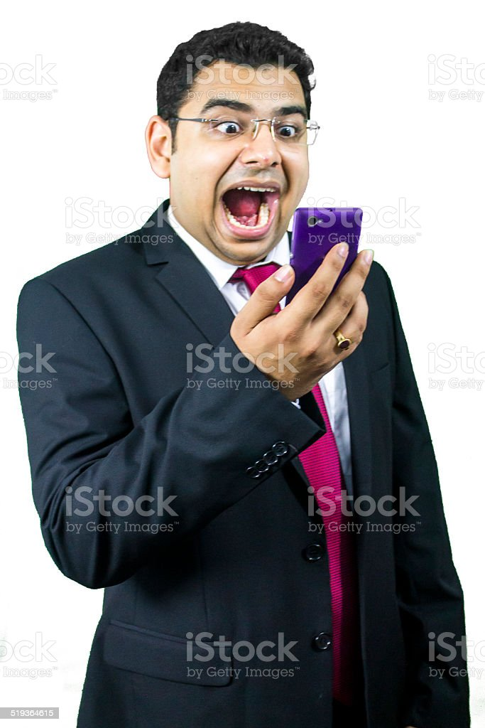 Young business man in anger on phone stock photo