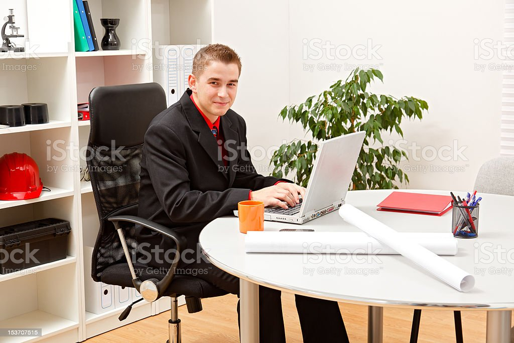 Young business man in office royalty-free stock photo