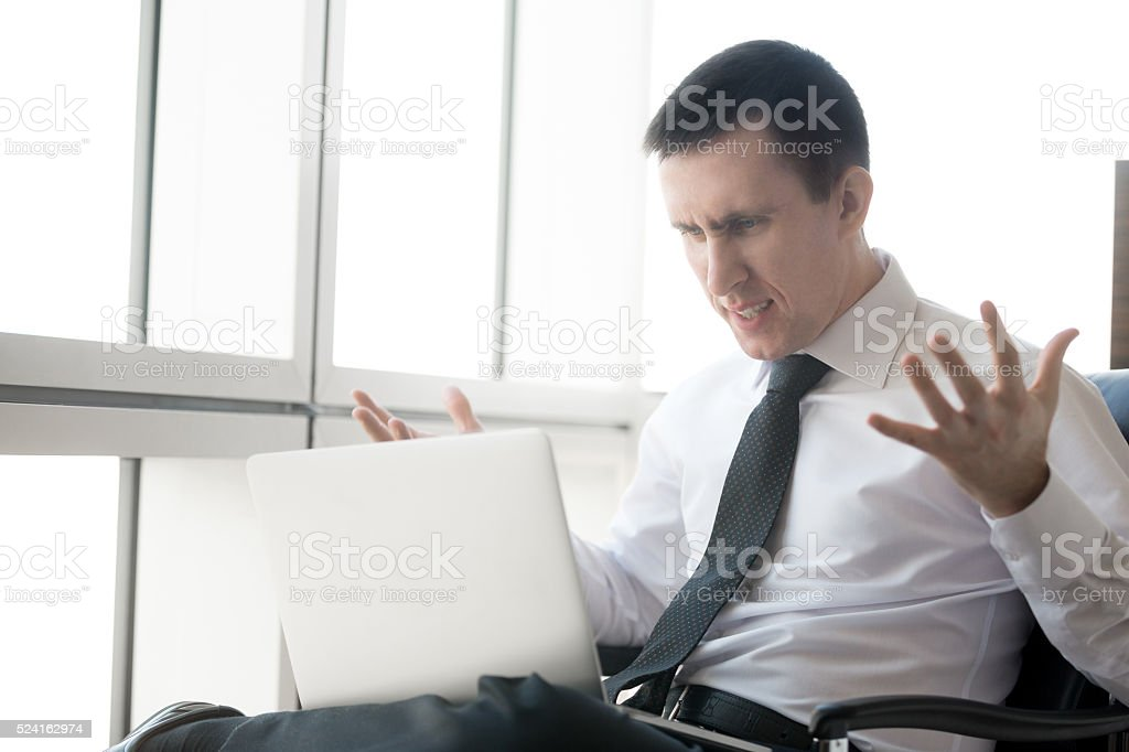 Young business man in stressful situation stock photo