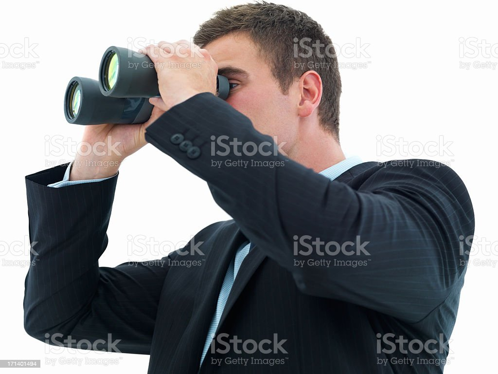 Young business man looking through binocular isolated on white royalty-free stock photo