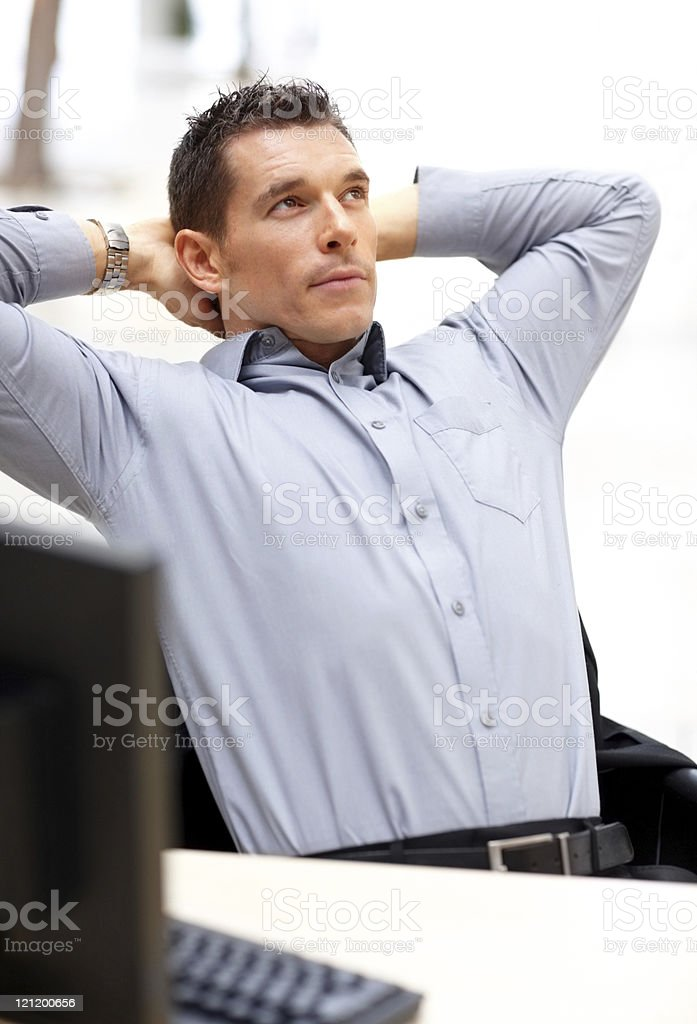 Young business man looking upwards in thought royalty-free stock photo