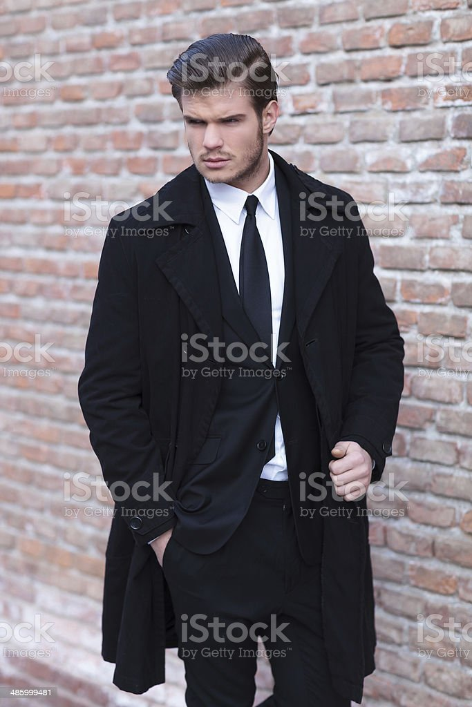 young business man looks at his side stock photo