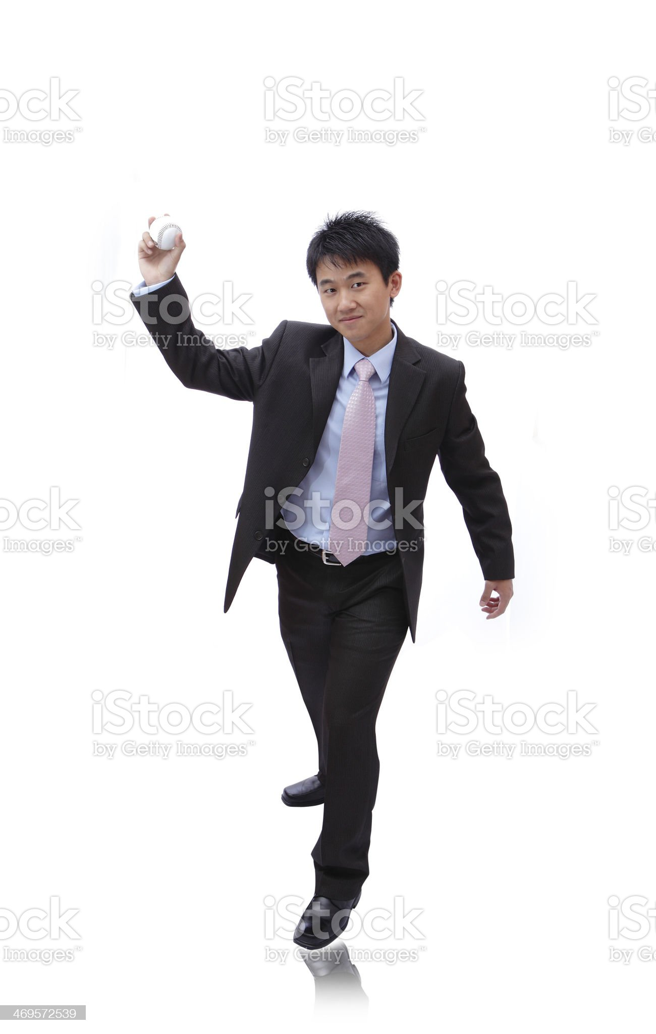 Young Business Man pitching baseball royalty-free stock photo