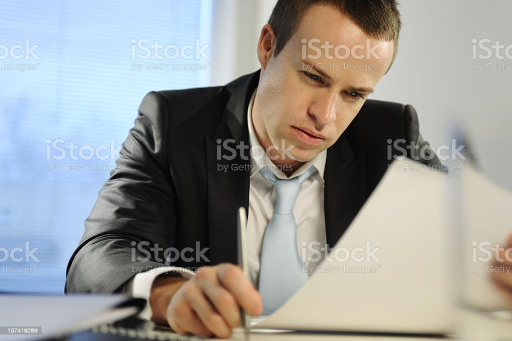 Young Business Man Reading Document royalty-free stock photo