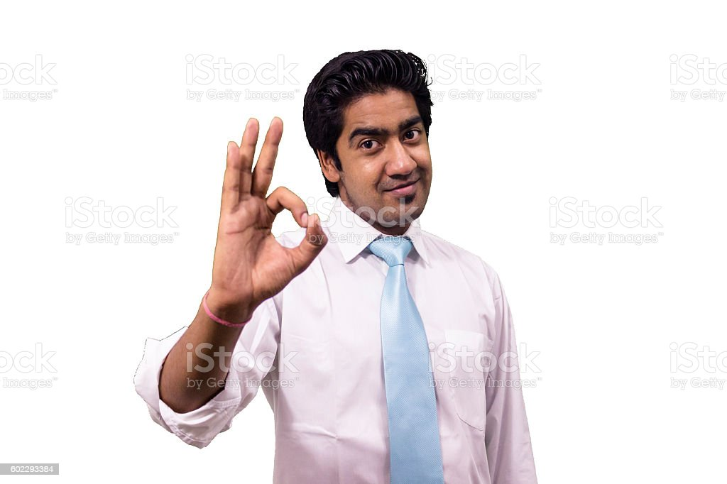 Young business man showing OK sign. stock photo