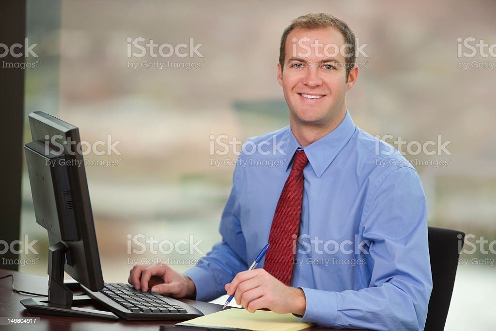 Young Business Man Sitting Behind Computer royalty-free stock photo