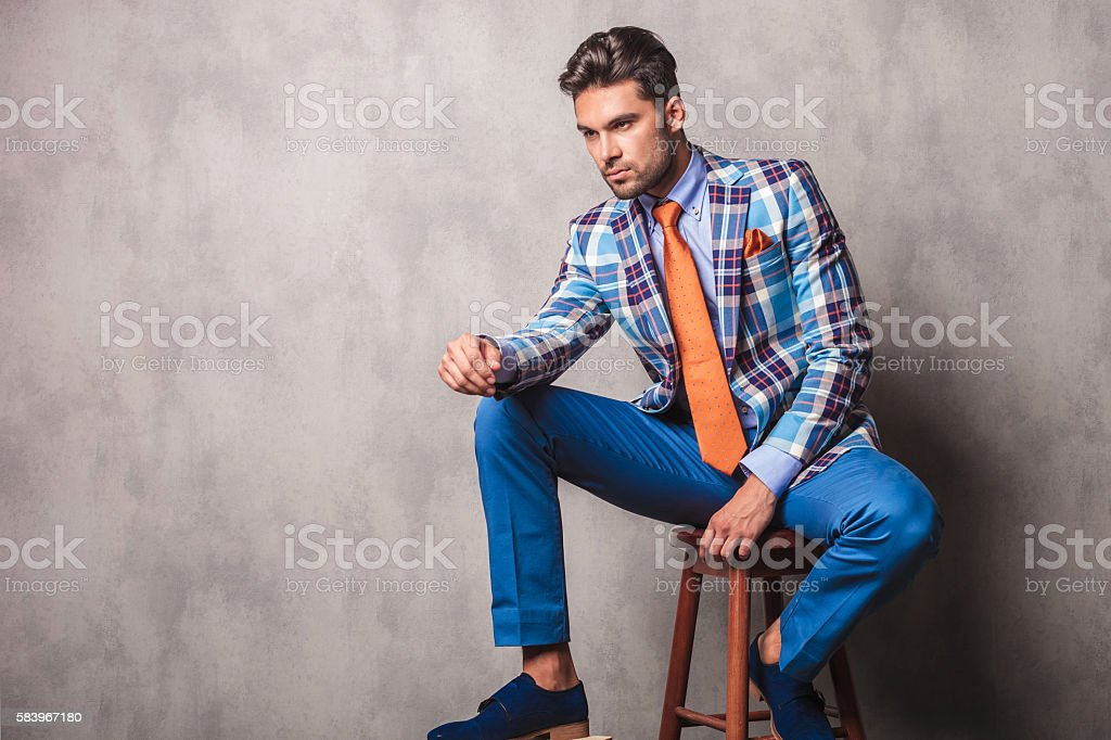 young business man sitting on a chair stock photo
