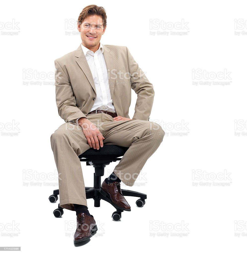 Young business man sitting on chair stock photo