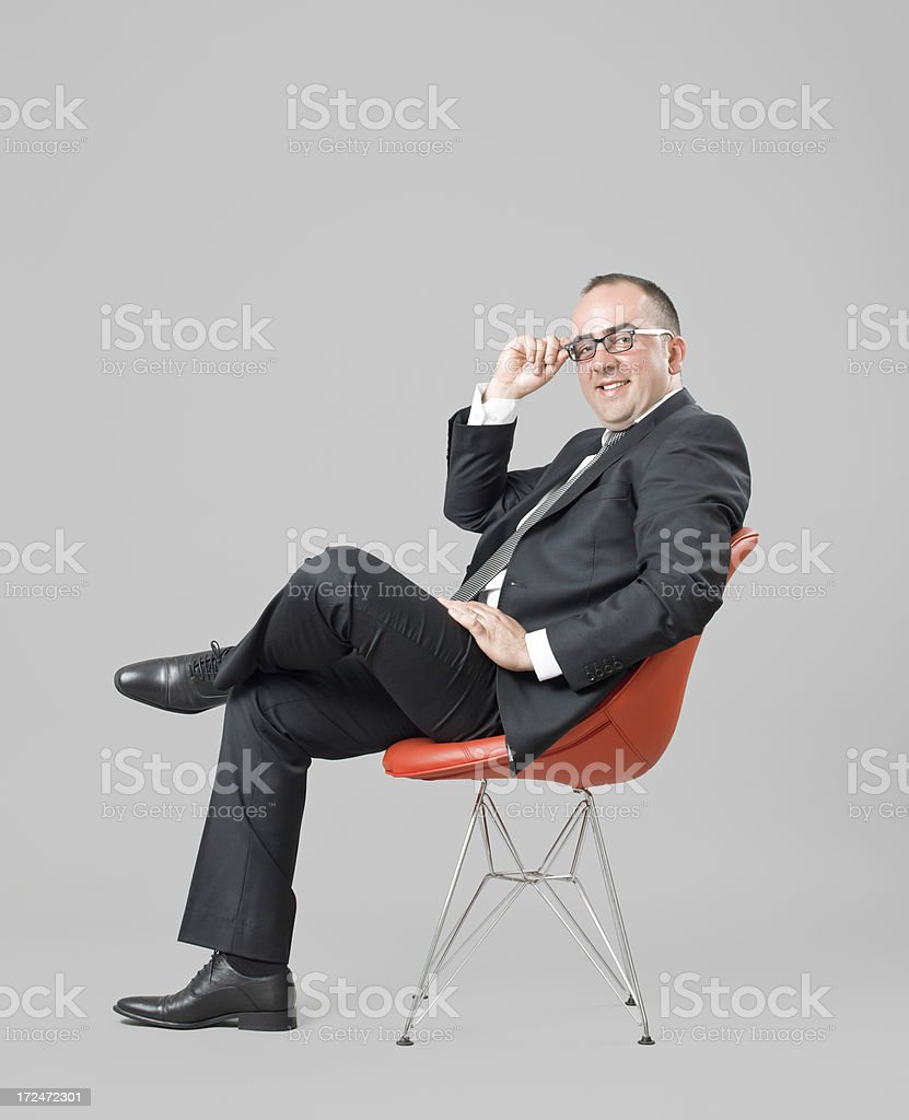 Young business man sitting on office chair royalty-free stock photo